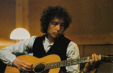 Dylan with guitar, 1974